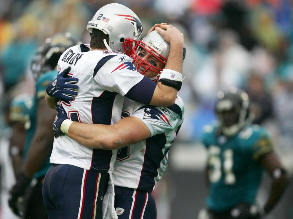 Tom Brady hugged tight end David Thomas (who caught a team-high five passes for 83 yards) after sealing the win.