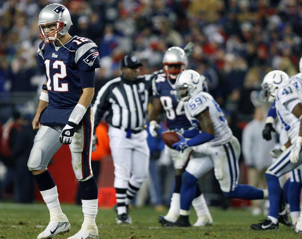 A dejected Tom Brady walked off the field after throwing a fourth-quarter interception.