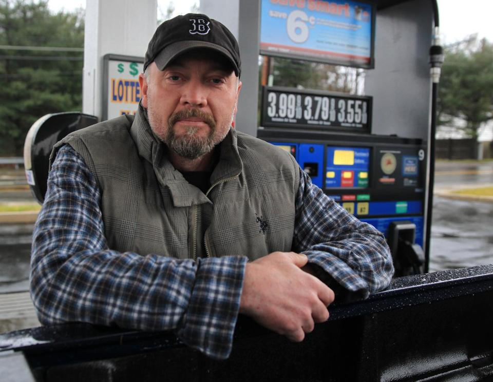 Scott Nutile filled up at a Waltham Mobil station where gas was $3.55 a gallon for regular.