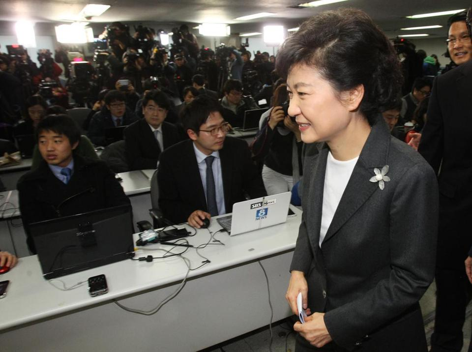 South Korea's president-elected Park Geun-hye left after a press conference at the headquarters of Saenuri Party in Seoul, South Korea, Thursday.