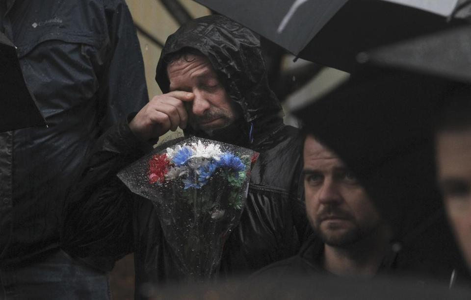 Joe Muxie teared up during a moment of silence at the Garden of Peace in Boston on the one-week anniversary of the shootings in Connecticut.