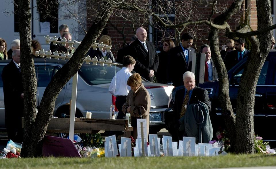 Mourners paused at a makeshift memorial Thursday as others left the funeral for Catherine Hubbard in Newtown.