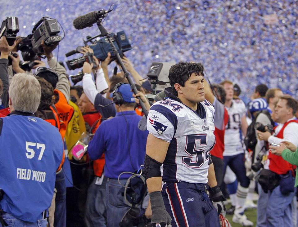 Tedy Bruschi walked off the field as the Colts' celebration began following their come-from-behind win.