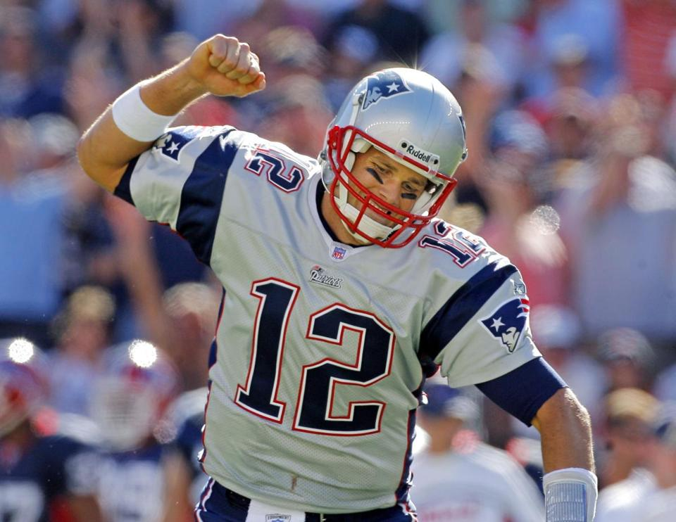 Tom Brady threw four touchdown passes against the Bills, including another two to Randy Moss.