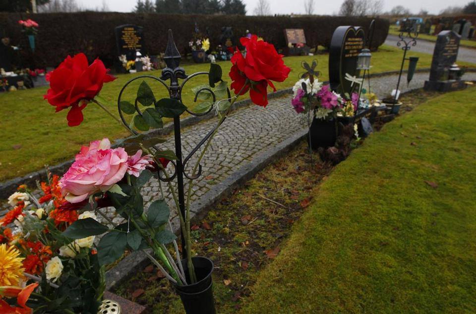 Flowers adorn the section of Dunblane Cemetery dedicated to the victims of the mass shooting at the Scottish town's primary school on March, 13, 1996.