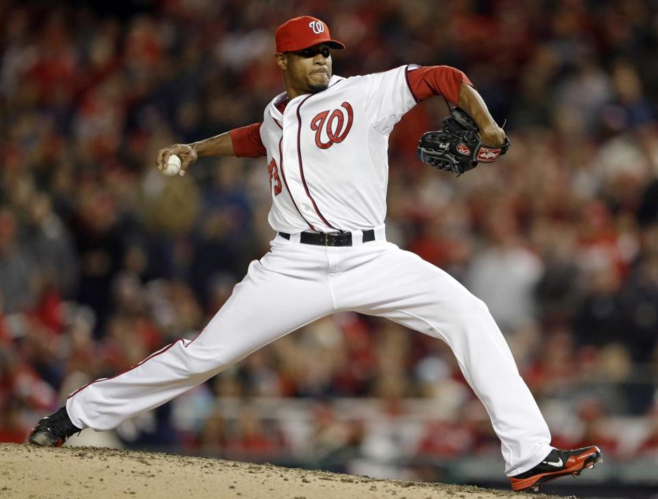 Washington Nationals pitcher Edwin Jackson threw to a St. Louis Cardinals batter during the seventh inning of Game 5 of the National League division baseball series on Friday, Oct. 12, 2012, in Washington.