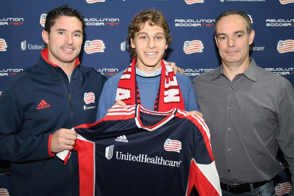 Revolution coach Jay Heaps (left) and GM Michael Burns flank the team's newest member, Scott Caldwell.