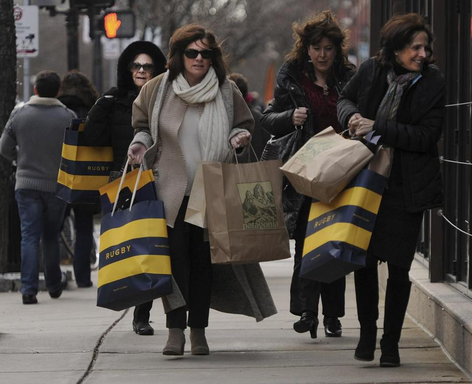 A steady trickle of late-morning shoppers on Newbury Street became a deluge by early afternoon.