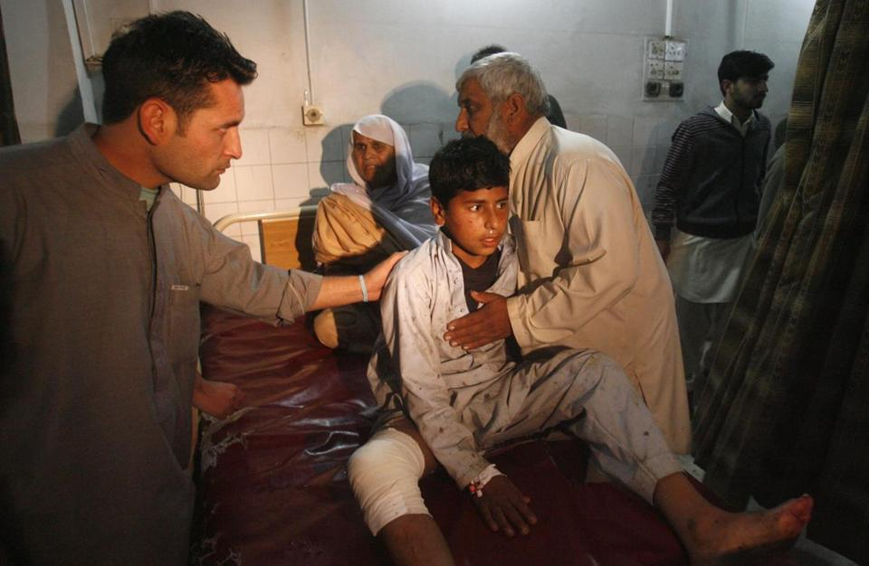A boy who was injured in a suicide bomb blast awaited treatment Saturday at a hospital in Peshawar, Pakistan. Among those killed was a provincial government official .