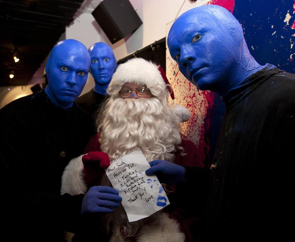 Globe Santa paid a visit Saturday to the Blue Man Group at the Charles Playhouse on Warrenton Street in Boston to pick up a Christmas list from the popular troupe.