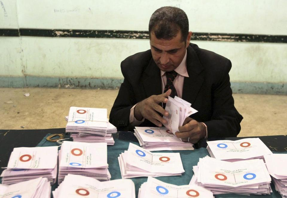 Early indications showed Egyptians approved an Islamist-drafted constitution after Saturday's final round of voting in a referendum despite the opposition's criticism of the measure as divisive.