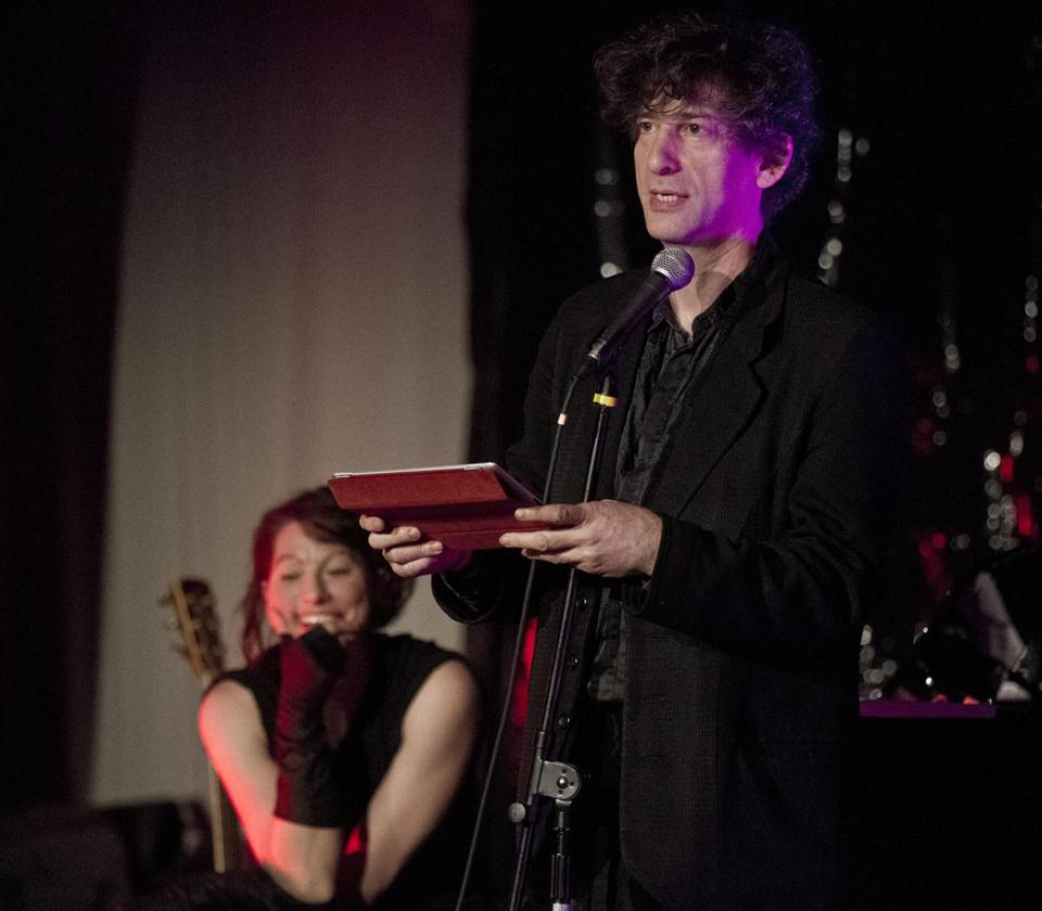 Above: Neil Gaiman (with Amanda Palmer in the background) reads from one of his books at the Gala Party in Dorchester.