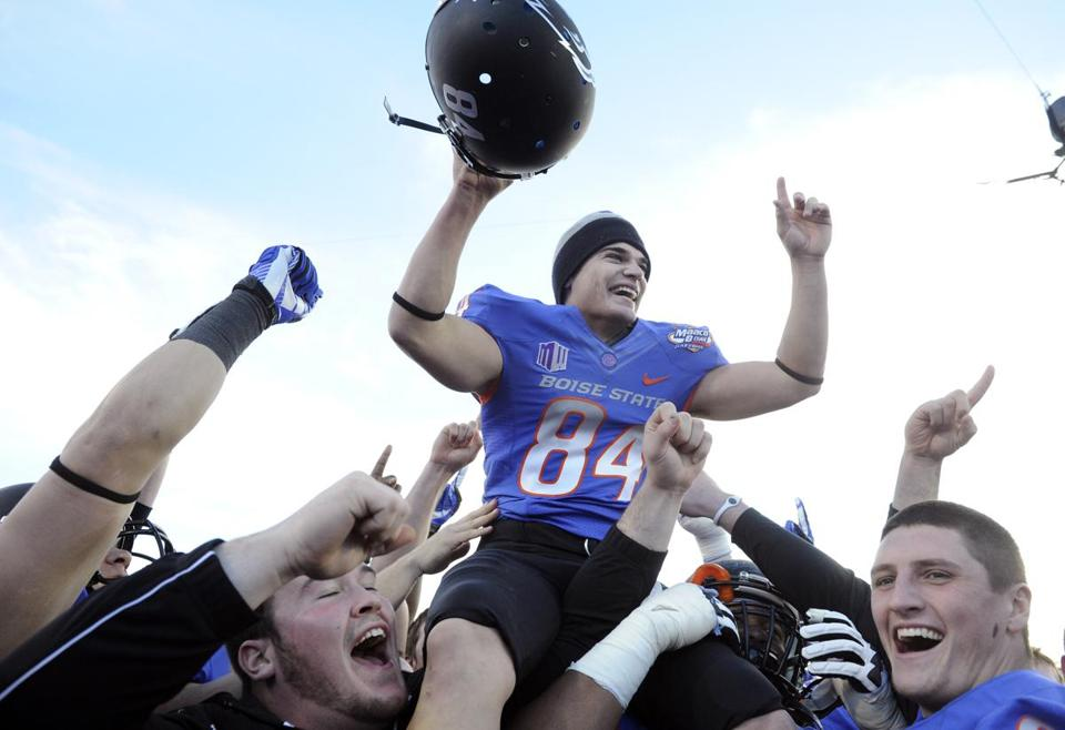 Boise State kicker Michael Frisina gets the hero treatment after his field goal decided the Las Vegas Bowl.