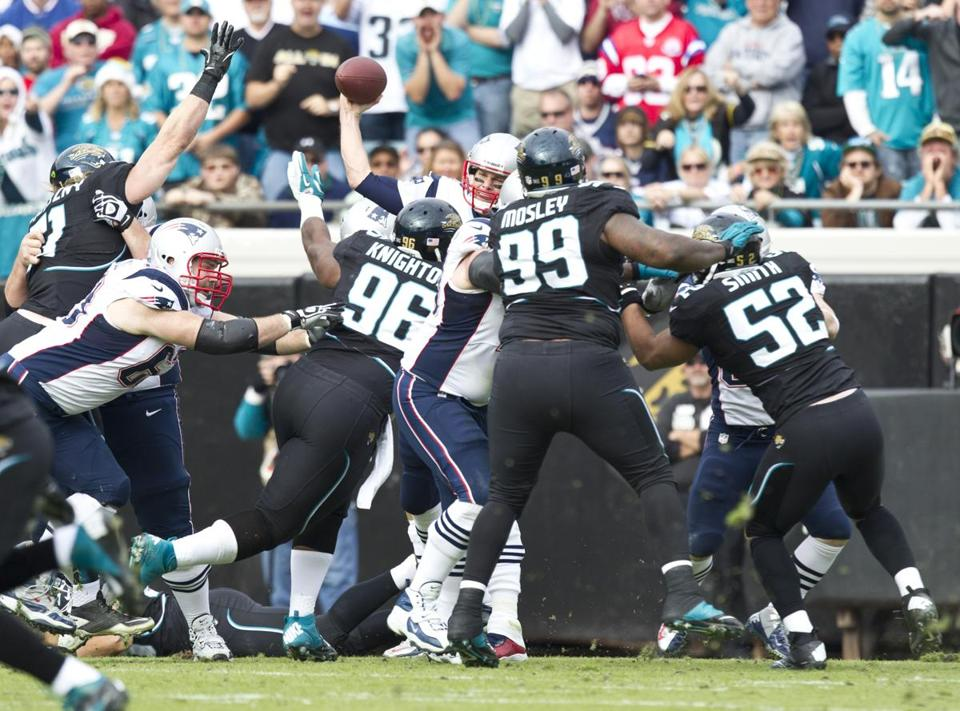 Quarterback Tom Brady, under siege by a persistent Jaguars defensive line, was sacked three times and received a total of 12 hits Sunday.