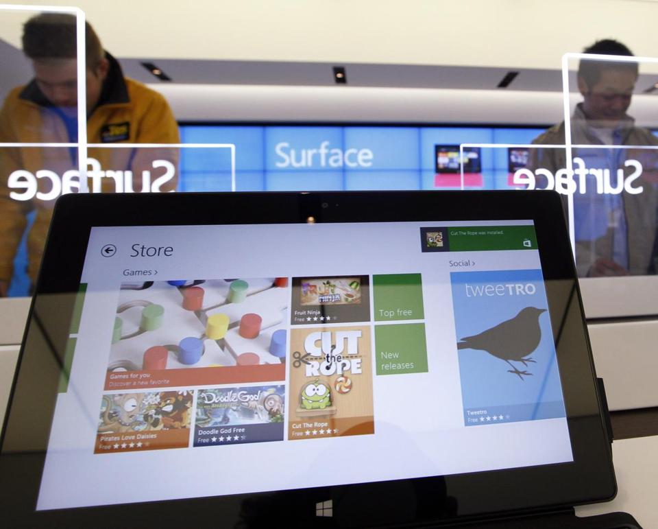 Shoppers in a Seattle Microsoft store checked out Surface tablets in October. Windows 8 sales have been slow so far.