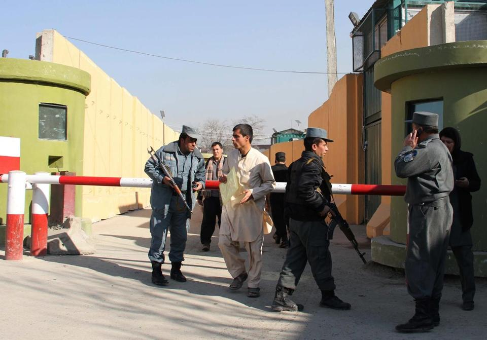 Afghan police stood guard outside the police compound where a female Afghan sergeant shot and killed a US military adviser for Afghan police in Kabul on Monday. The victim was identified as Joseph Griffin, 49, of Mansfield, Ga. Police do not believe the attack was an act of terrorism.