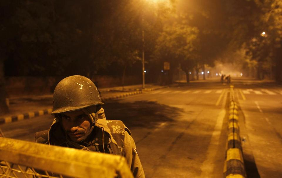 A police officer guarded a road that was blocked to stop demonstrators from advancing Monday in New Delhi.