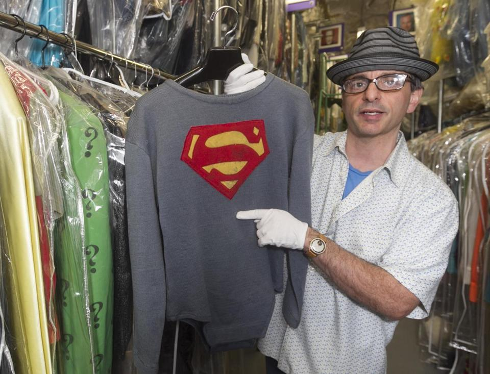 "James Comisar with the costume George Reeves wore in the TV show ""Adventures of Superman."""