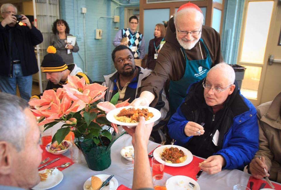 Cardinal Sean P. O'Malley helped serve a Christmas Eve luncheon Monday at the Pine Street Inn homeless shelter in the South End. The inn was expected to serve more than 1,000 people, as volunteers helped to decorate the dining rooms and prepare the meal. Also serving was Boston City Councilor Tito Jackson.