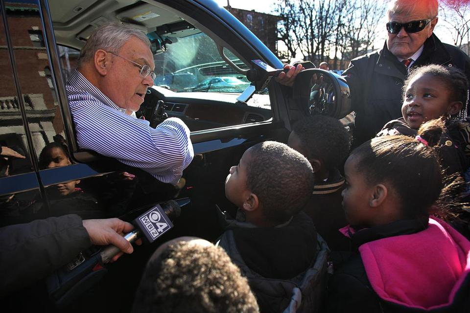 Boston Mayor Thomas Menino greeted children on Christmas Even at the Catholic Charities Teen Center in Dorchester.