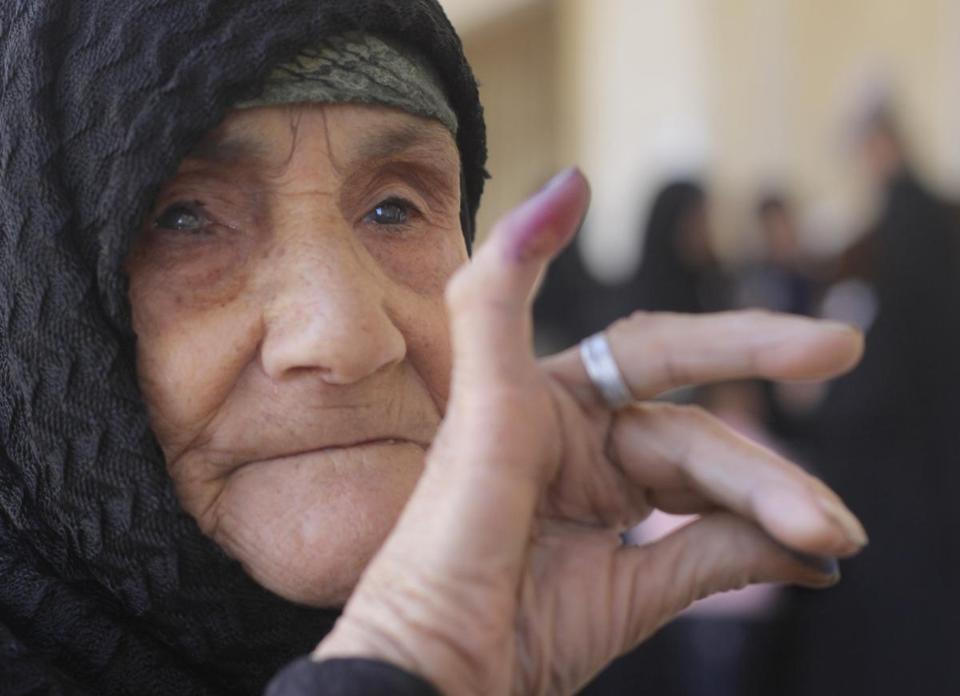 Amnah Sayyed Moussa, 85, displayed her inked finger after she cast her vote on the new constitution in Giza, Egypt.