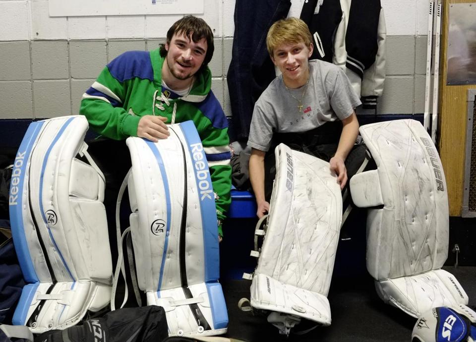 Franklin High School goalies Mike Donadio, left, and Devon Maloof adjusted their equipment before practice.