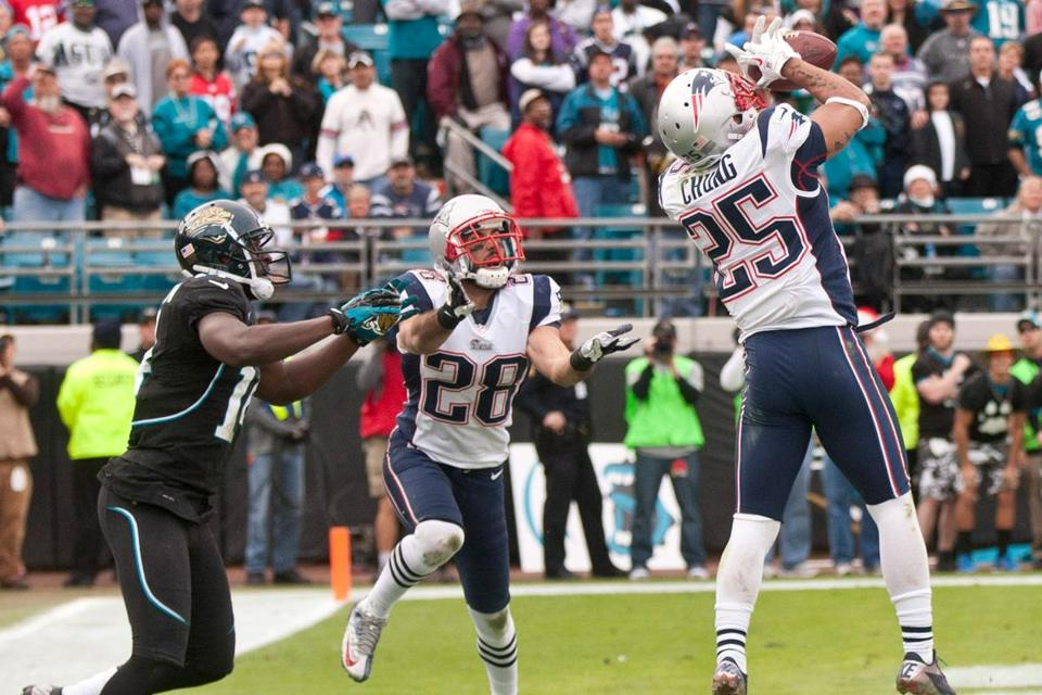 Patrick Chung intercepts the ball in front of teammate Steve Gregory and the Jaguars' Justin Blackmon, sealing the game on its final play.