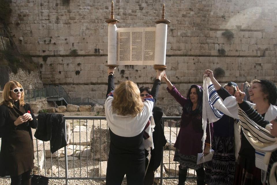 Women of the Wall members held a Torah during prayers outside the Western Wall.