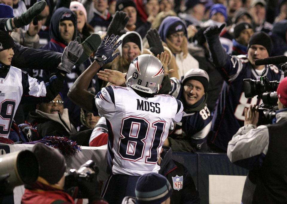 Randy Moss celebrated after scoring one of his four touchdowns in the first quarter.