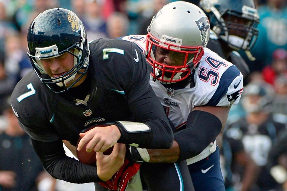 Patriots linebacker Dont'a Hightower sacks the Jaguars' Chad Henne in Sunday's game.