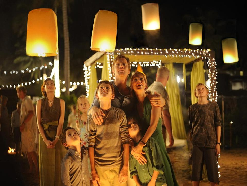 "Foreground (from left): Samuel Joslin, Tom Holland, Oaklee Pendergast, Ewan McGregor, and Naomi Watts in ""The Impossible."""