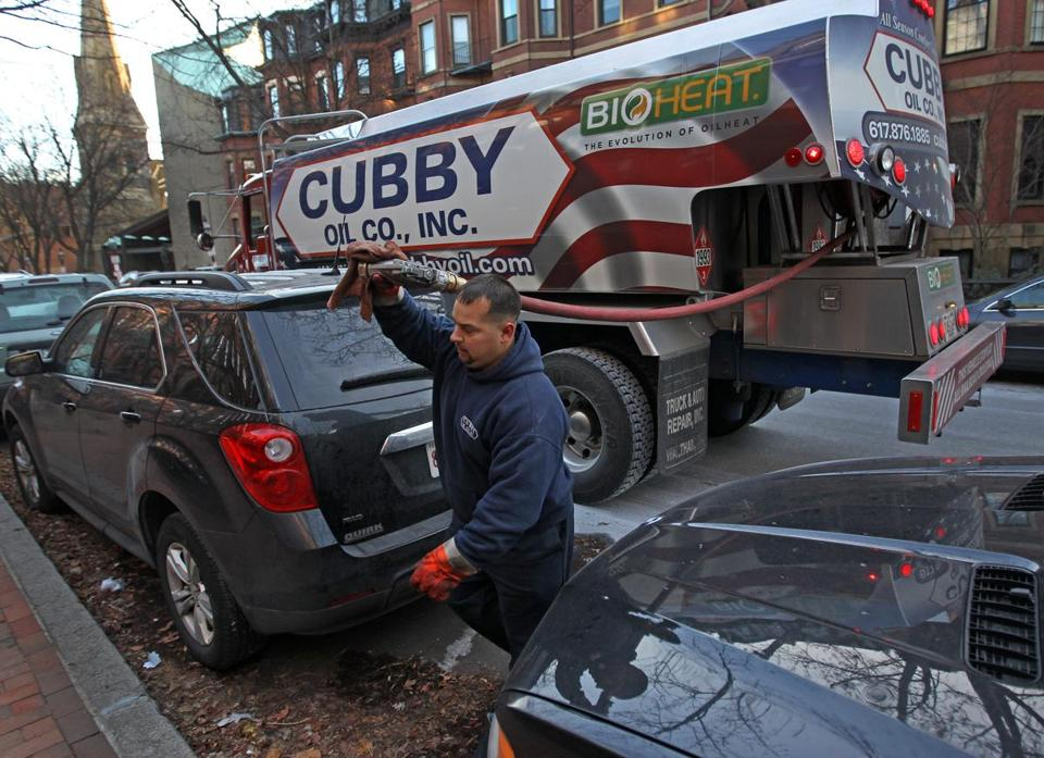 Cubby Oil's John Alefantis on a recent delivery. Less than one-third of Massachusetts homes heat with fuel oil, according to census figures.