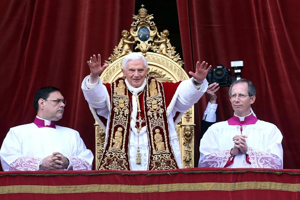 Pope Benedict XVI spoke from the central balcony of St. Peter's Basilica as the faithful filled the square below him. He called for an end to the slaughter in Syria.