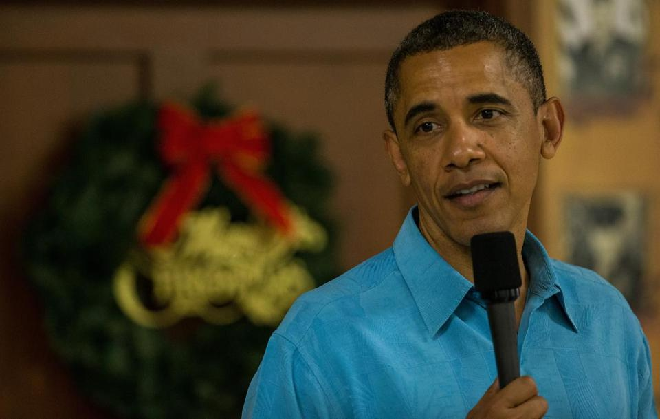 President Obama visited military personnel eating Christmas dinner at a Marine Corps base in Hawaii on Tuesday.