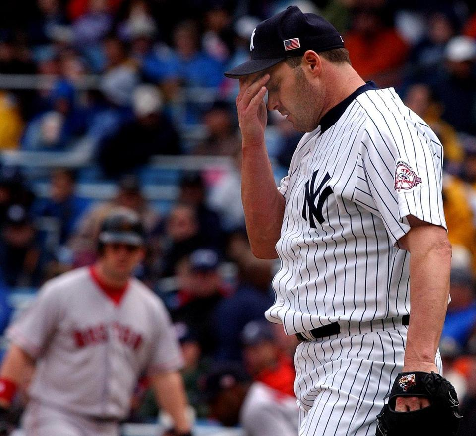 Roger Clemens, pitching for the Yankees, falls short of his 300th career win against the Boston Red Sox on May 26, 2003. He reached the goal that June.