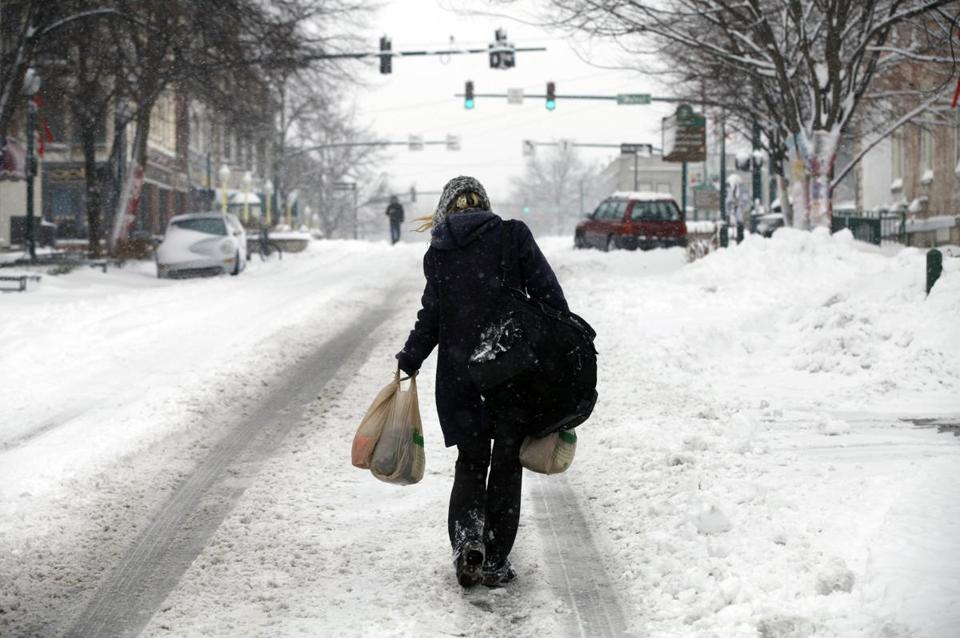 A woman struggled with groceries in Bloomington, Ind. In some parts of the state, snow fell at the rate of 3 inches per hour and state plows slid off roads.