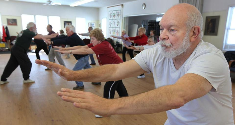 A tai chi lesson was filled with participants last year at the Acton Senior Center, where renovations have been placed on hold in part to avoid reducing space for exercise classes.