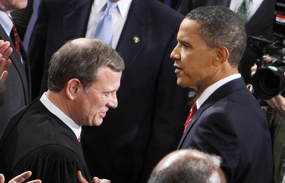 President Barack Obama greets Chief Justice John Roberts before delivering his State of the Union Address on Capitol Hill in Washington in 2012.