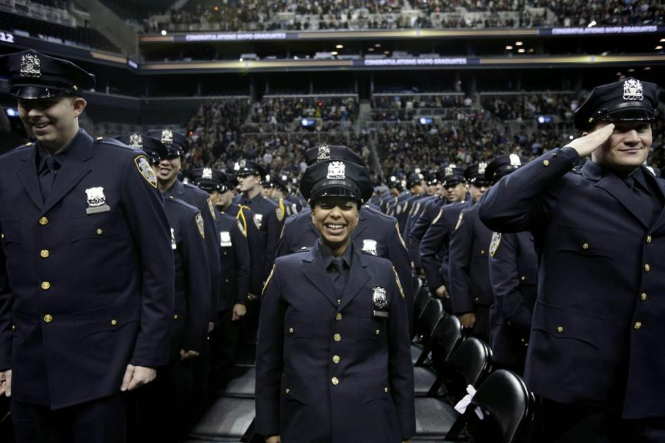 As New York police recruits graduated, officials said the number of murders will probably hit a record low in 2012.