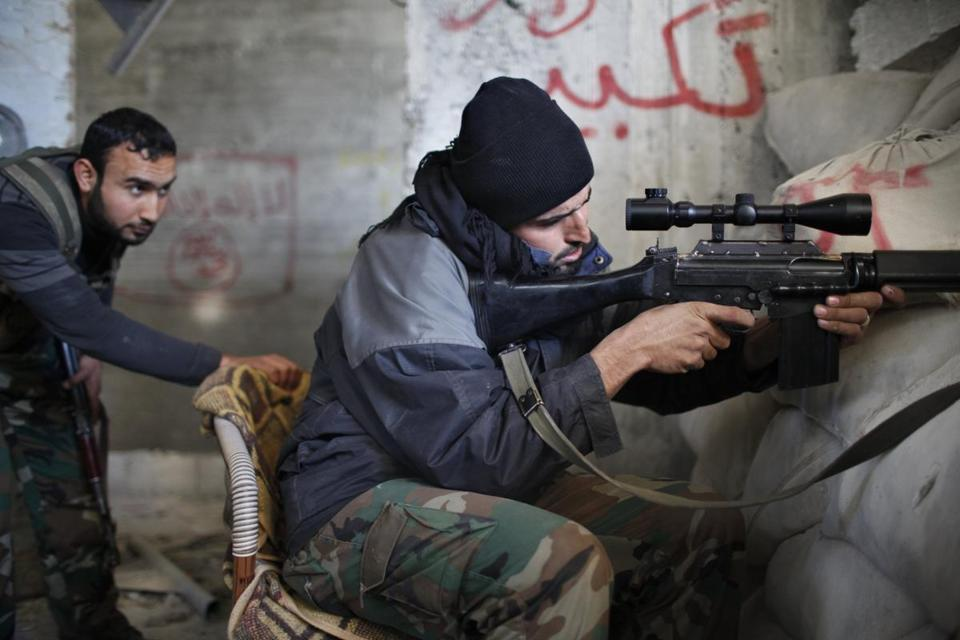 A rebel sniper fired at forces loyal to President Bashar Assad in Aleppo on Saturday. Syria will be overrun by violence if no peace deal is reached, an international mediator said.