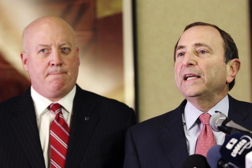 Gary Bettman (right), Bill Daly and the NHL will have a conference call with the players' union on Saturday.