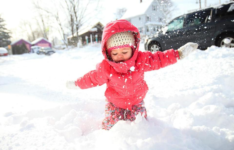 Marcella Bourassa, 2, waded through her first snowfall on Sunday in Milford.