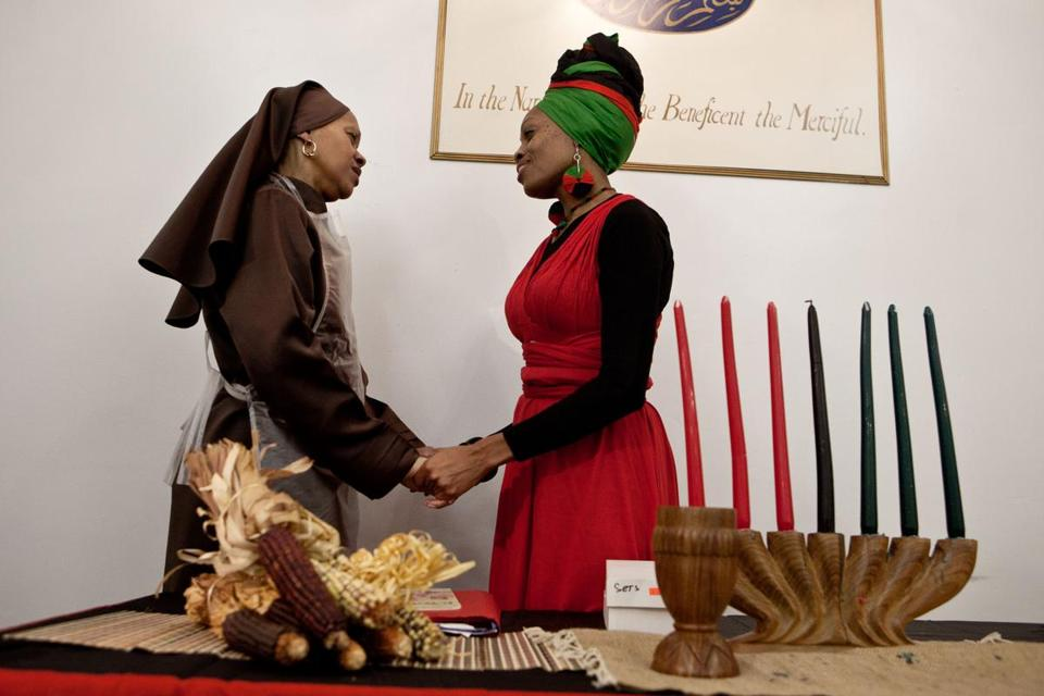 For the fourth night of Kwanzaa, Carla Muhammad (left) and Phyllis Muhammad marked the holiday at Muhammad's Mosque No. 11 in Dorchester. Kwanzaa runs from Dec. 26 through Jan.1.