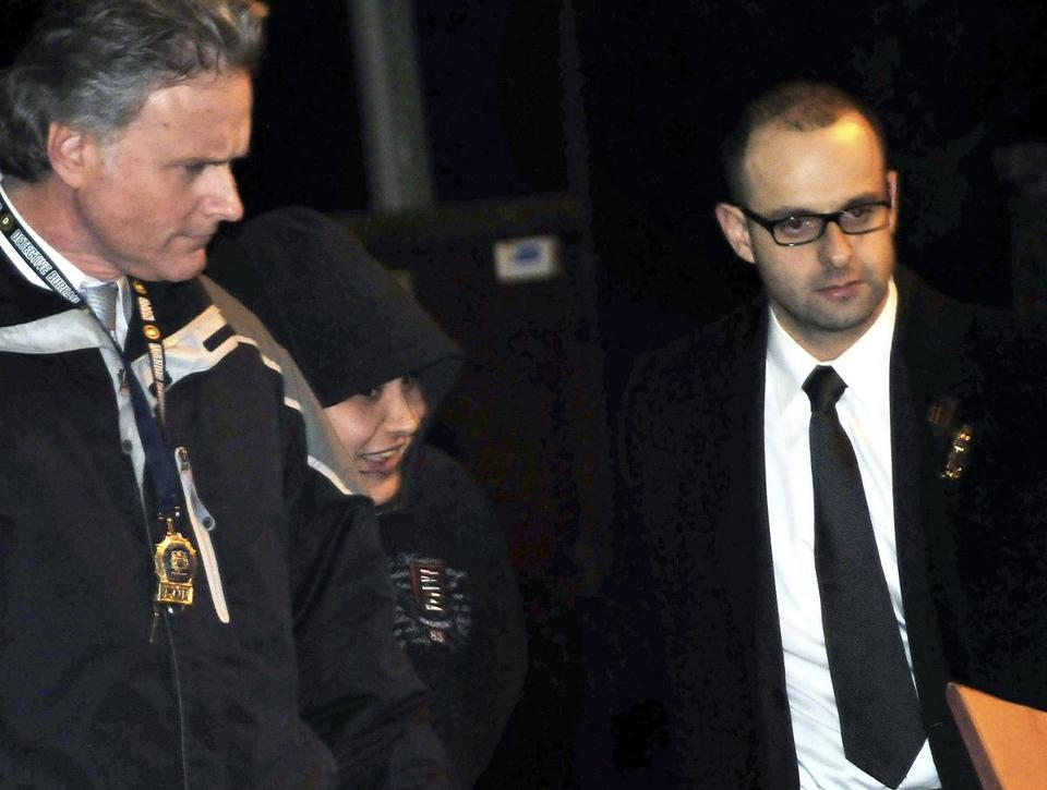 New York detectives escorted Erika Menendez (second from left), who was charged with murder as a hate crime.