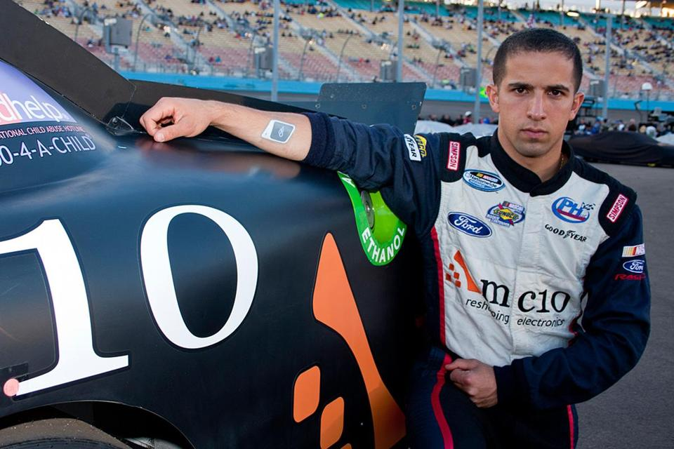 NASCAR driver Paulie Harraka helped test a sensor (on forearm) from MC10 Inc., of Cambridge, that monitors fluid levels.