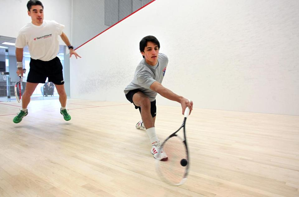 Thierry Lincou, left, and Farhan Zaman train at Dover Squash & Fitness.