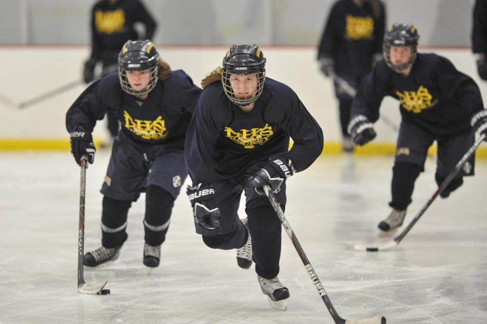 Jackie Denning, center, led teammates Sarah Lehman, left, and Carolyn Avery down the ice.