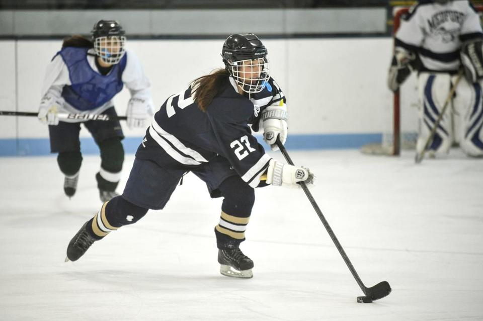 Brittani Lanzilli brought the puck up ice at practice for the Medford High girls' squad.