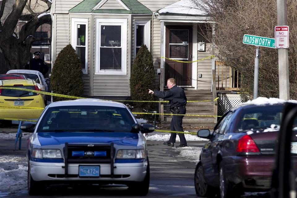 A police officer directed pedestrian traffic near the scene of a fatal stabbing Tuesday on Pratt Street in Allston. A neighbor said a dispute over unwanted guests at the party may have preceded the stabbing, Boston's first homicide of 2013.