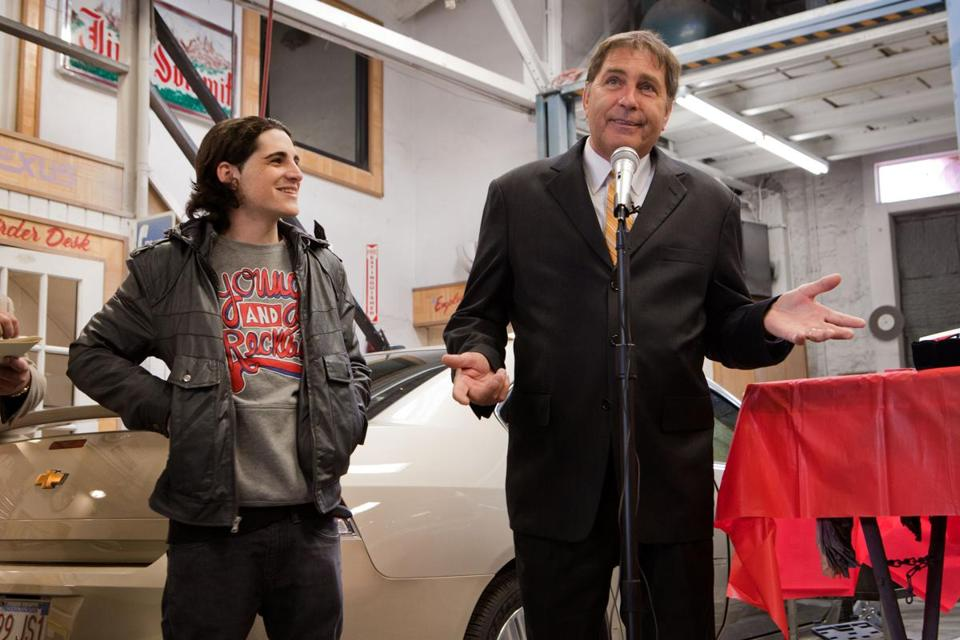 "State Representative Stephen ""Stat"" Smith honors James Massone for his performance on the show, The Voice, at Malden Auto Body shop in Everett on March 9, 2012."